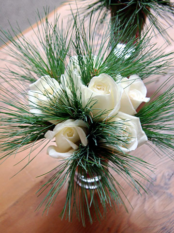 White roses and pine boughs