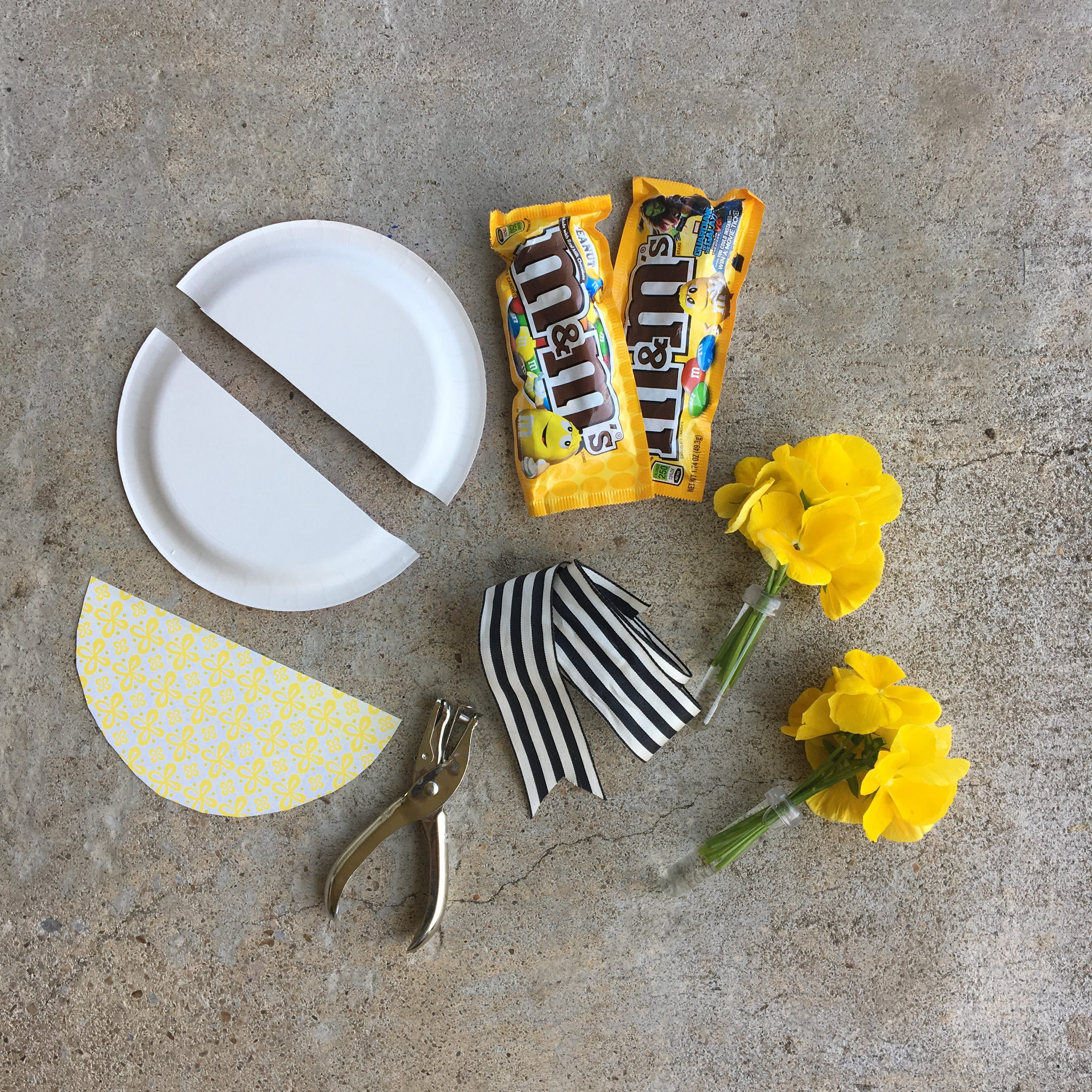 Five ways to make may day baskets the neat nook youll need a small paper plate cut in half a piece of pretty paper cut to the size of one of the halves flowers candies and ribbon mightylinksfo